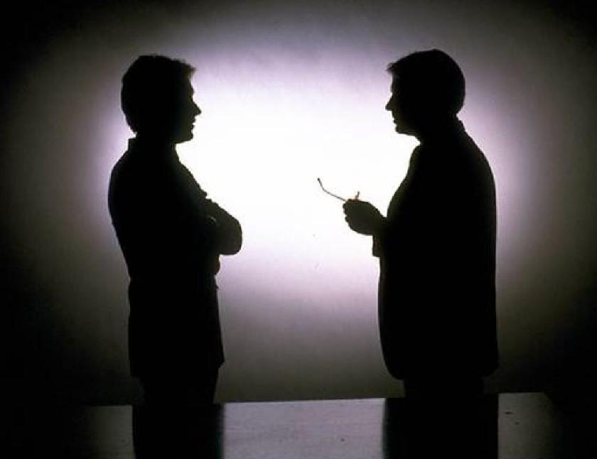 2_men_talking_silouette